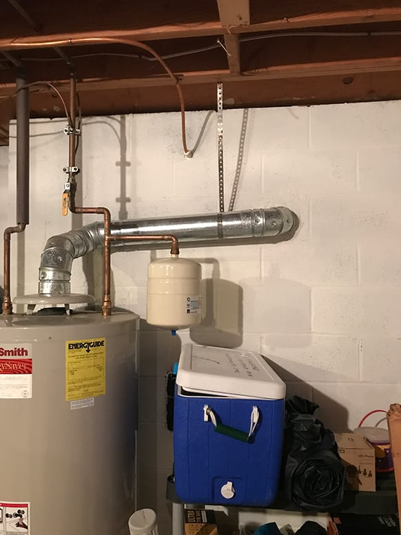 Natural gas water heater venting into chimney