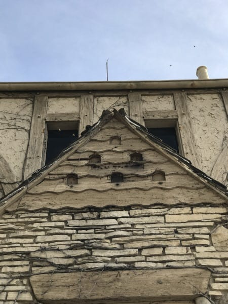 Built-in birdhouses on a gable end