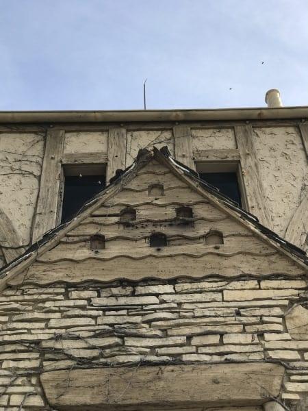 Built-in birdhouses on a gable end